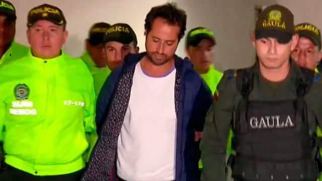 Rafael Uribe Noguera, cuando era trasladado a su primera audiencia en los juzgados de Paloquemao. Foto: caracol.com