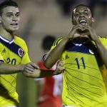 Colombia's forward Jeison Lucumi (R) celebrates his goal against Chile next to his teammate forward Rafael Borre during the South American U-20 football match at Domingo Burgueno stadium in Maldonado, 130 km east of Montevideo, on January 19, 2015.  AFP PHOTO / PABLO PORCIUNCULA
