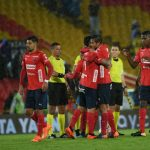 Jugadores del DIM celebran Gol de Cano ante Millonarios