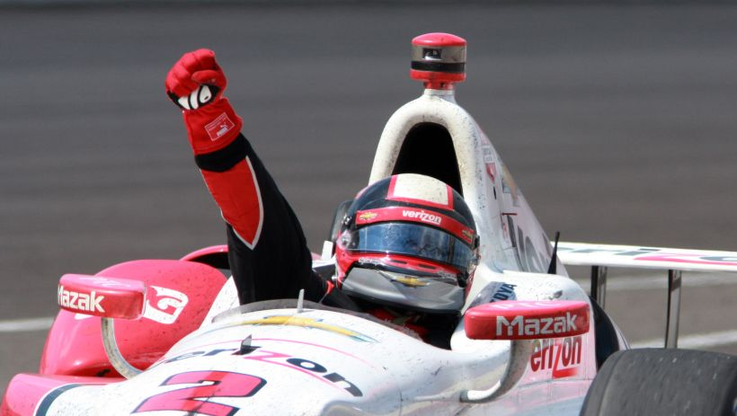 Juan Pablo Montoya, of Colombia,  celebrates as he returns to the pit area after winning the 99th running of the Indianapolis 500 auto race at Indianapolis Motor Speedway in Indianapolis, Sunday, May 24, 2015.  (AP Photo/Mike McKown)