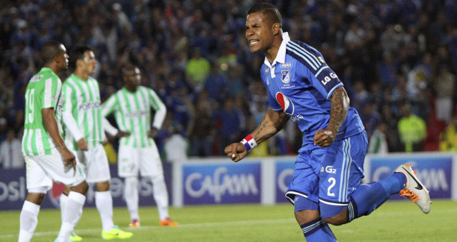 BOGOTA, COLOMBIA – FEBRUARY 09: Roman Torres of Millonarios celebrates a scored goal against Atletico Nacional during a match between Millonarios and Atletico Nacional as part of the  Liga Postobon I 2004  at Nemesio Camacho  El Campin Stadium on February  09 , 2014 in Bogota, Colombia. (Photo by Felipe Caicedo/ LatinContent /Getty Images)