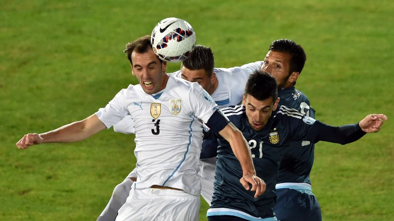 Uruguay's defender  Diego Godin (L) Uruguay's defender  Jose Maria Gimenez (BACK) Argentina's defender Ezequiel Garay (L) and Argentina's midfielder Javier Pastore vie during their 2015 Copa America football championship match, in La Serena, Chile, on June 16, 2015.  AFP PHOTO / CRIS BOURONCLE