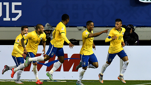 Brazil's midfielder Douglas Costa (2-R) celebrates with teammates after scoring against Peru during their 2015 Copa America football championship match in Temuco, Chile, on June 14, 2015. Brazil won 2-1.    AFP PHOTO / NELSON ALMEIDA        (Photo credit should read NELSON ALMEIDA/AFP/Getty Images)