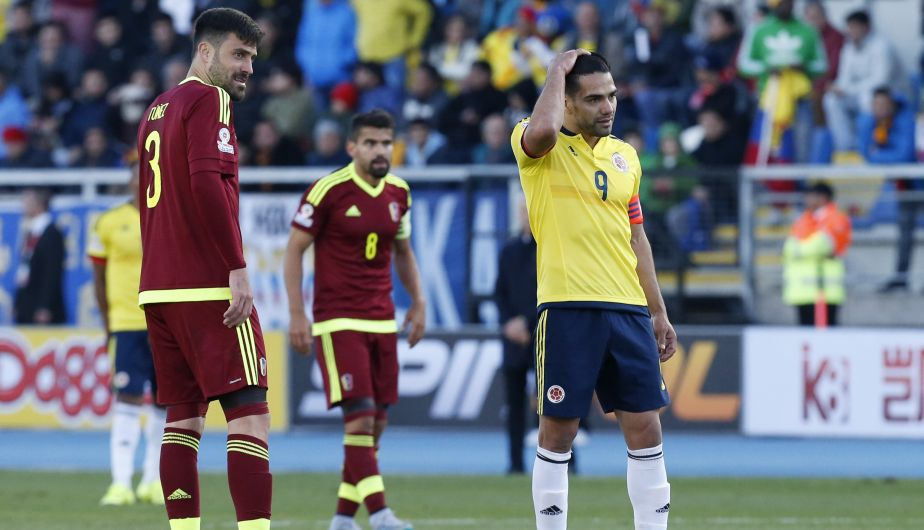 Colombia's Radamel Falcao Garcia gestures at the end of a Copa America Group C soccer match as Venezuela's Andres Tunez, left, and Venezuela's Tomas Rincon, center, look on at El Teniente stadium in Rancagua, Chile, Sunday, June 14, 2015. (AP Photo/Luis Hidalgo)