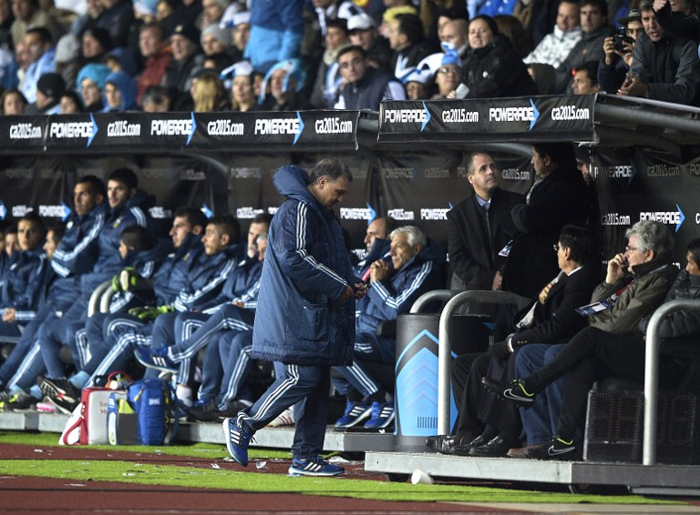Argentina's coach Gerardo Martino leaves the field after being sent off by Brazilian referee Sandro Meira Ricci, during their 2015 Copa America football championship match against Uruguay, in La Serena, Chile, on June 16, 2015.   AFP PHOTO / JUAN MABROMATA
