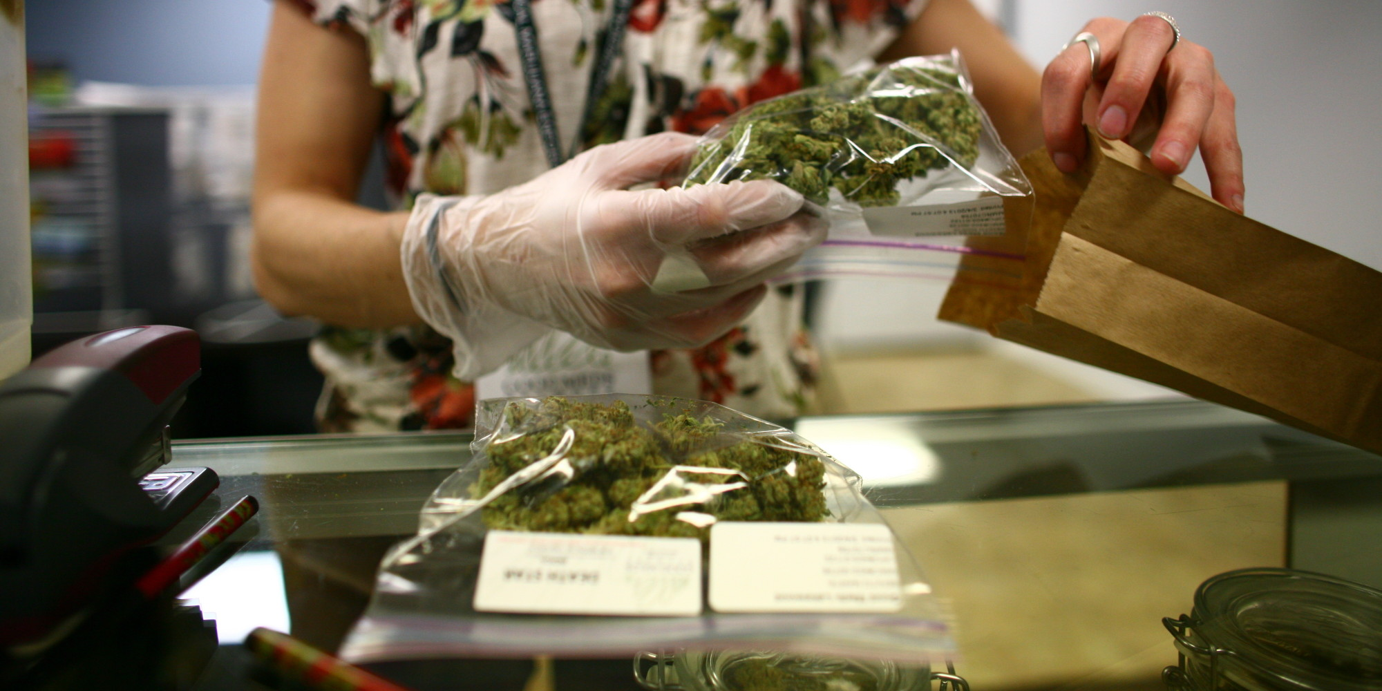 Lakewood, CO - MARCH, 4:  Sales associate, Crystal Guess packages up a patient's cannabis inside a Good Meds medical cannabis center in Lakewood, Colorado, U.S., on Monday, March 4, 2013.   This is at a Good Meds medical cannabis center in Lakewood, and is one of the facilities that Kristi Kelly, Co-Founder of Good Meds Network, operates. (Photo by Matthew Staver/For The Washington Post via Getty Images)