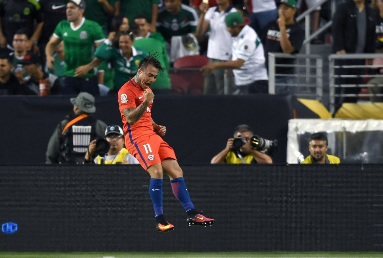 SANTA CLARA, CA - JUNE 18: Eduardo Vargas #11 of Chile celebrates after he scored a goal against Mexico during the 2016 Copa America Centenario Quarterfinals match play between Mexico and Chile at Levi's Stadium on June 18, 2016 in Santa Clara, California.   Thearon W. Henderson/Getty Images/AFP