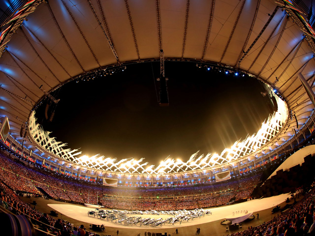 RIO DE JANEIRO, BRAZIL - AUGUST 05: Fireworks explode while dancers perform during the Opening Ceremony of the Rio 2016 Olympic Games at Maracana Stadium on August 5, 2016 in Rio de Janeiro, Brazil. (Photo by Christian Petersen/Getty Images)
