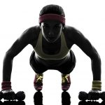 21975859 - one  woman exercising fitness workout push ups  in silhouette  on white background