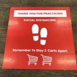 Social Distancing sign on the floor of grocery store