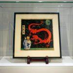 """La pintura de la portada original del libro de caricaturas """"El Loto Azul"""" (Lotus Bleu) de Tintín (1936) en exhibición antes de la subasta de Artcurial en París, Francia. REUTERS/Noemie Olive."""