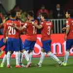 Chile's midfielder Arturo Vidal (C L) celebrates with teammates after scoring against Mexico during their 2015 Copa America football championship match, in Santiago, on June 15, 2015.  AFP PHOTO / RODRIGO ARANGUA
