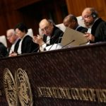 President of the International Court of Justice Ronny Abraham (2nd R) looks at a document during the court case of the border dispute between Costa Rica and Nicaragua at the International Court of Justice in the Hague, the Netherlands on December 16, 2015. A UN court on December 16 ruled Nicaragua had violated Costa Rica's sovereignty in a long-standing row over disputed territory on the San Juan river which has soured ties between the two neighbours. / AFP / ANP / Bas Czerwinski / Netherlands OUT